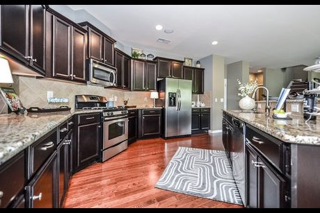 B  C  Kitchen. Fairfield Plan at Kinmere Farms   Enclave in Gastonia  North