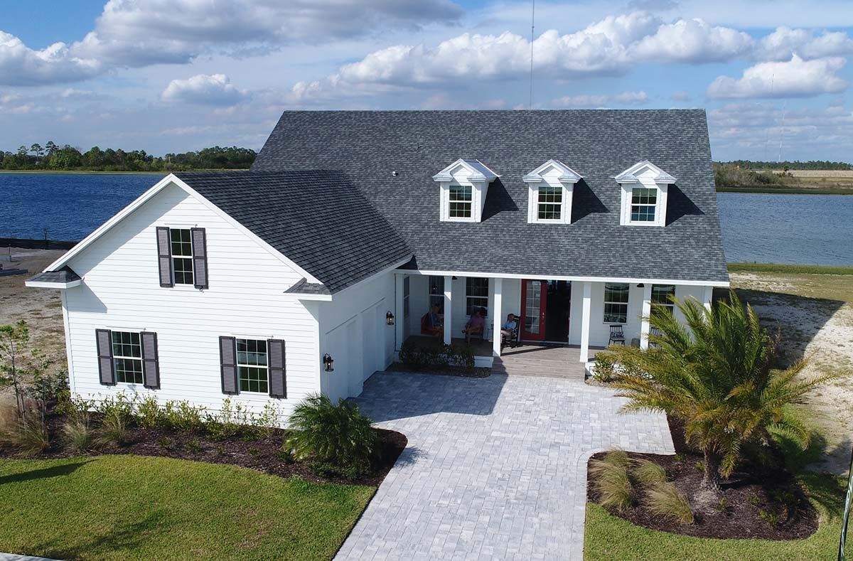 Exterior featured in The Lauren at Lake Timber By Florida Lifestyle Homes in Punta Gorda, FL