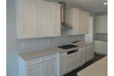 Kitchen-in-The Maple-at-Forest Edge Reserve-in-Northville