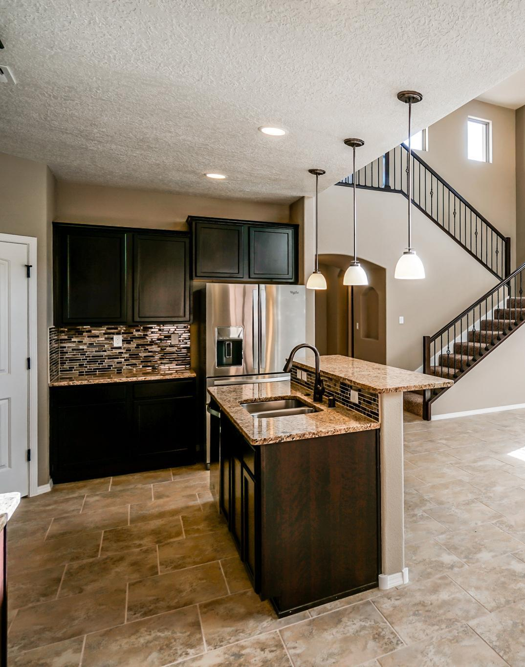 Kitchen featured in The Taylor with Optional 3rd Car Garage By Abrazo Homes in Albuquerque, NM