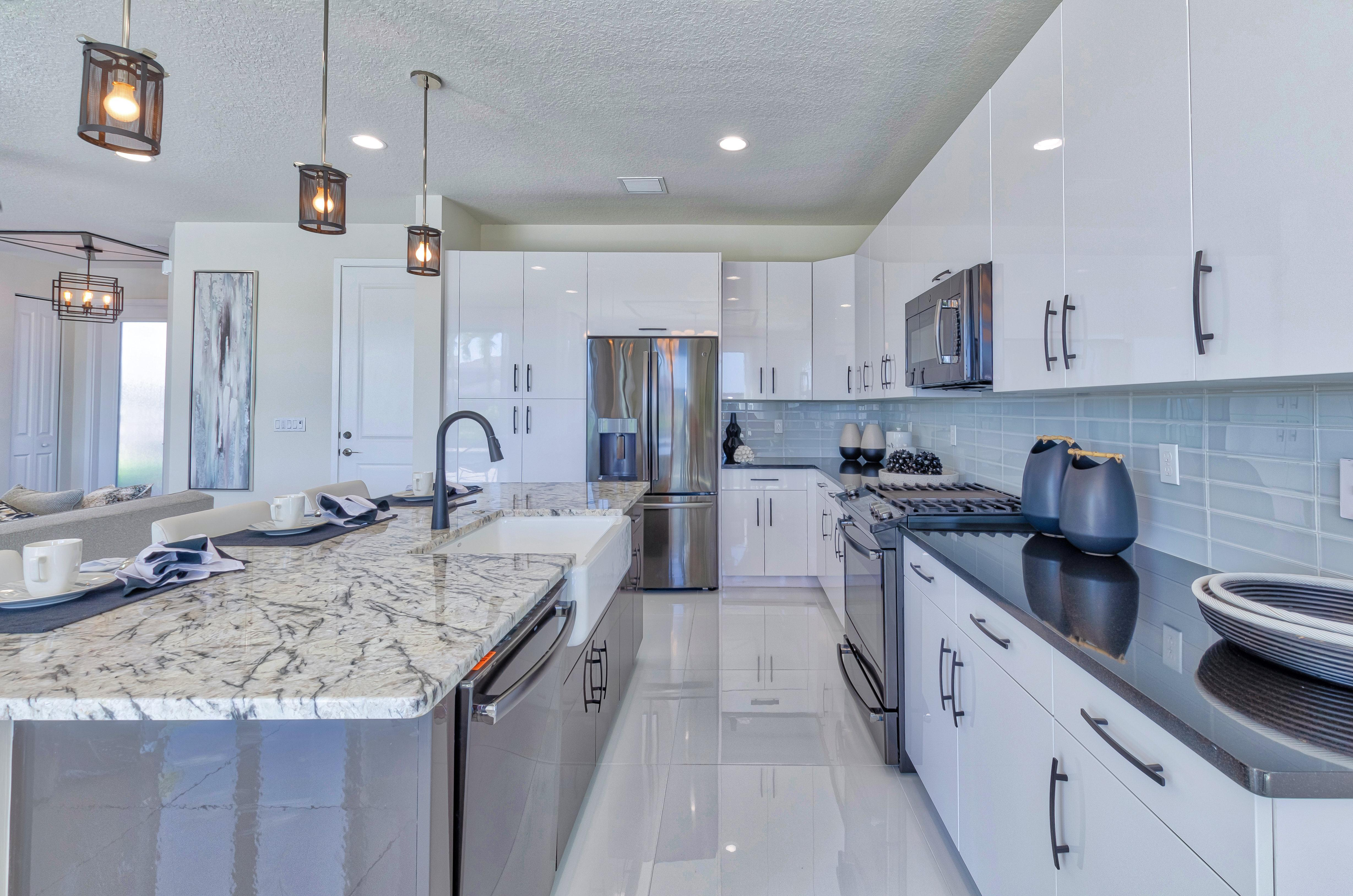 Kitchen featured in the Costa By Akel Homes in Palm Beach County, FL