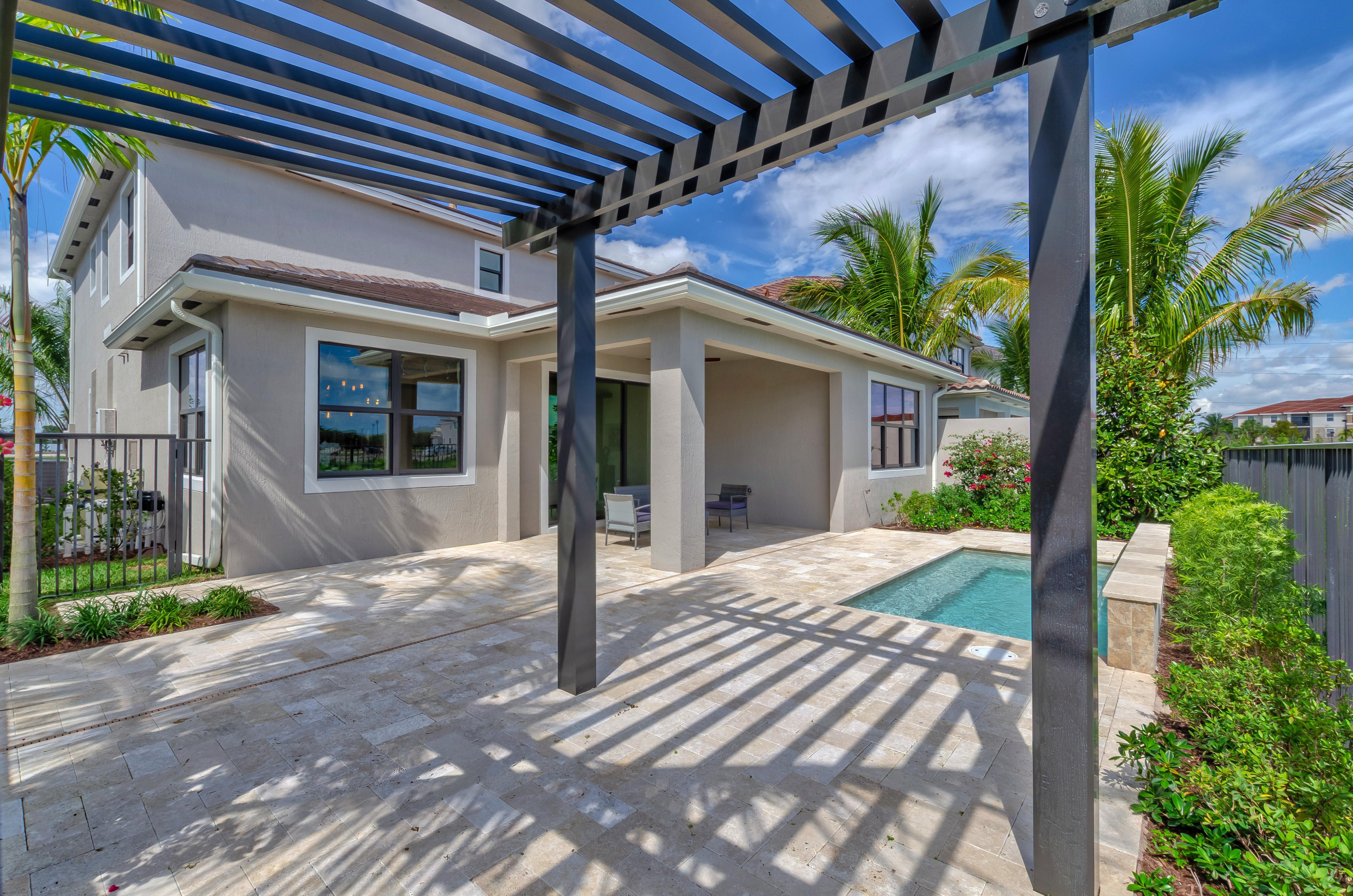 Exterior featured in the Sierra By Akel Homes in Palm Beach County, FL