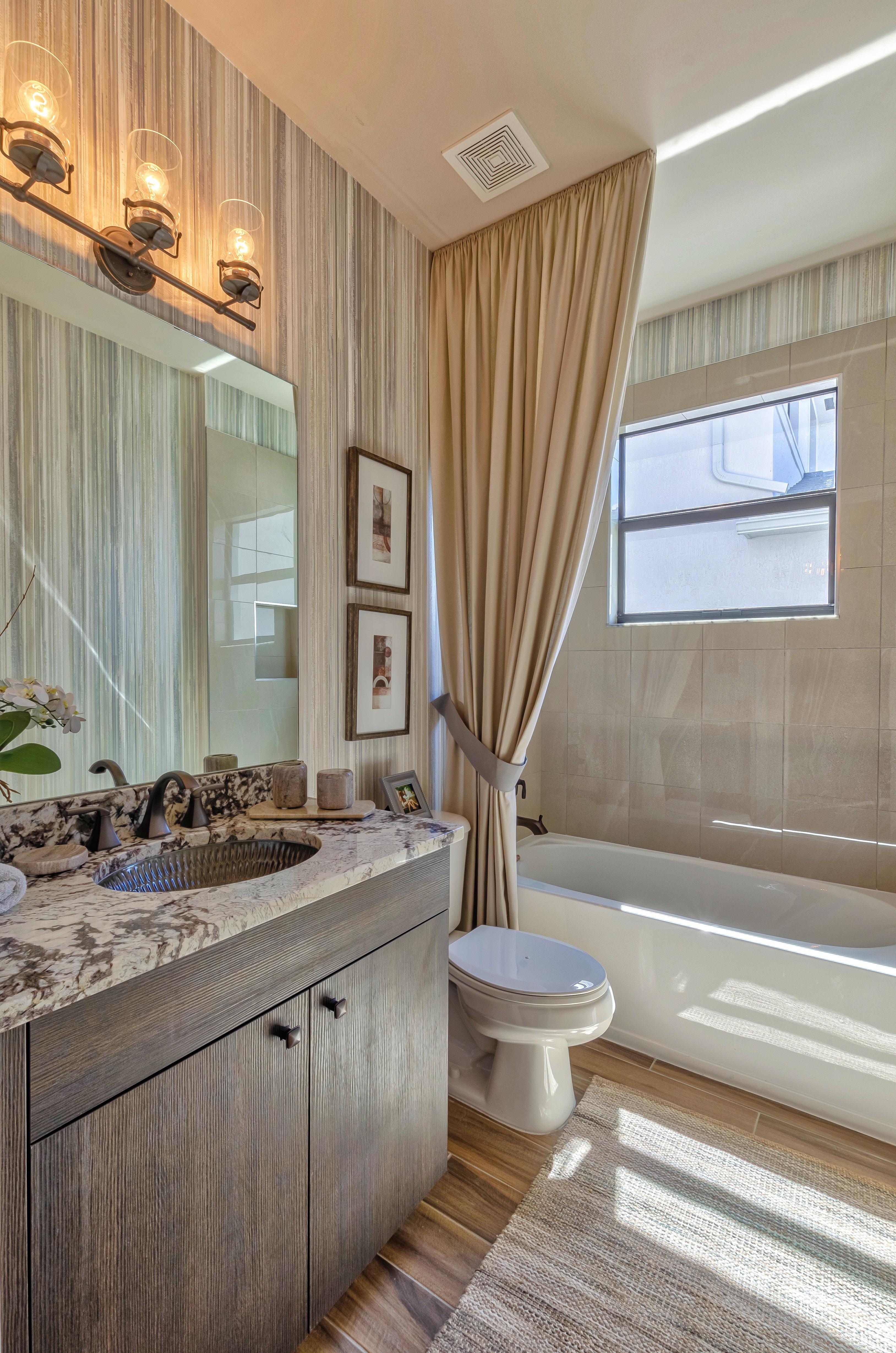 Bathroom featured in the Sierra By Akel Homes in Palm Beach County, FL