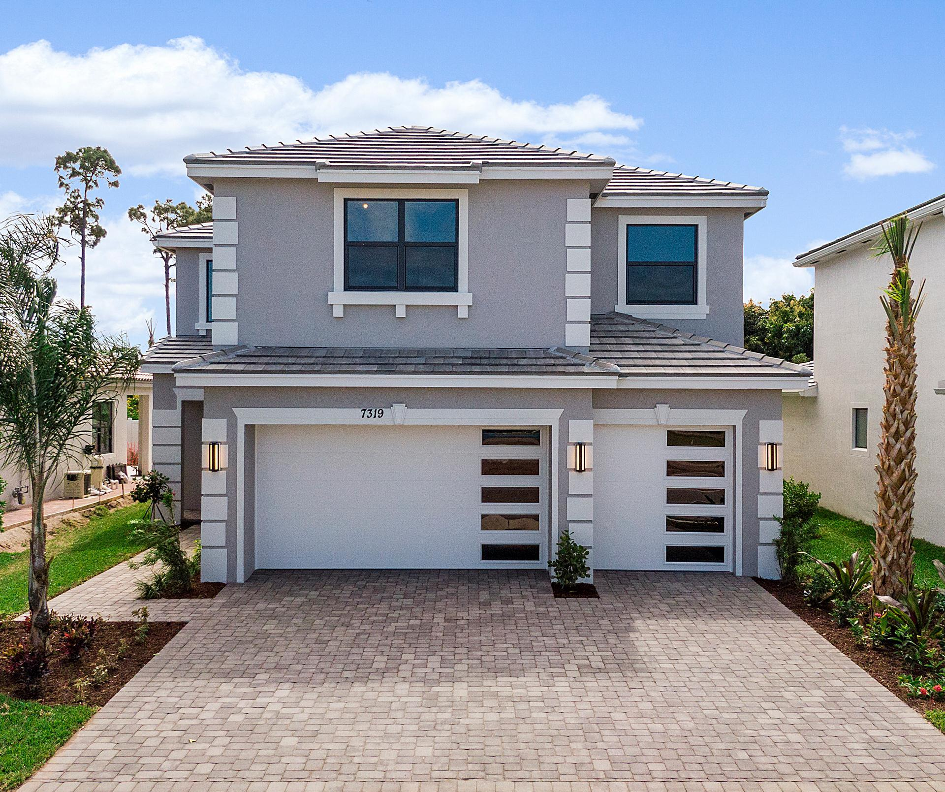 Exterior featured in the Riviera By Akel Homes in Palm Beach County, FL
