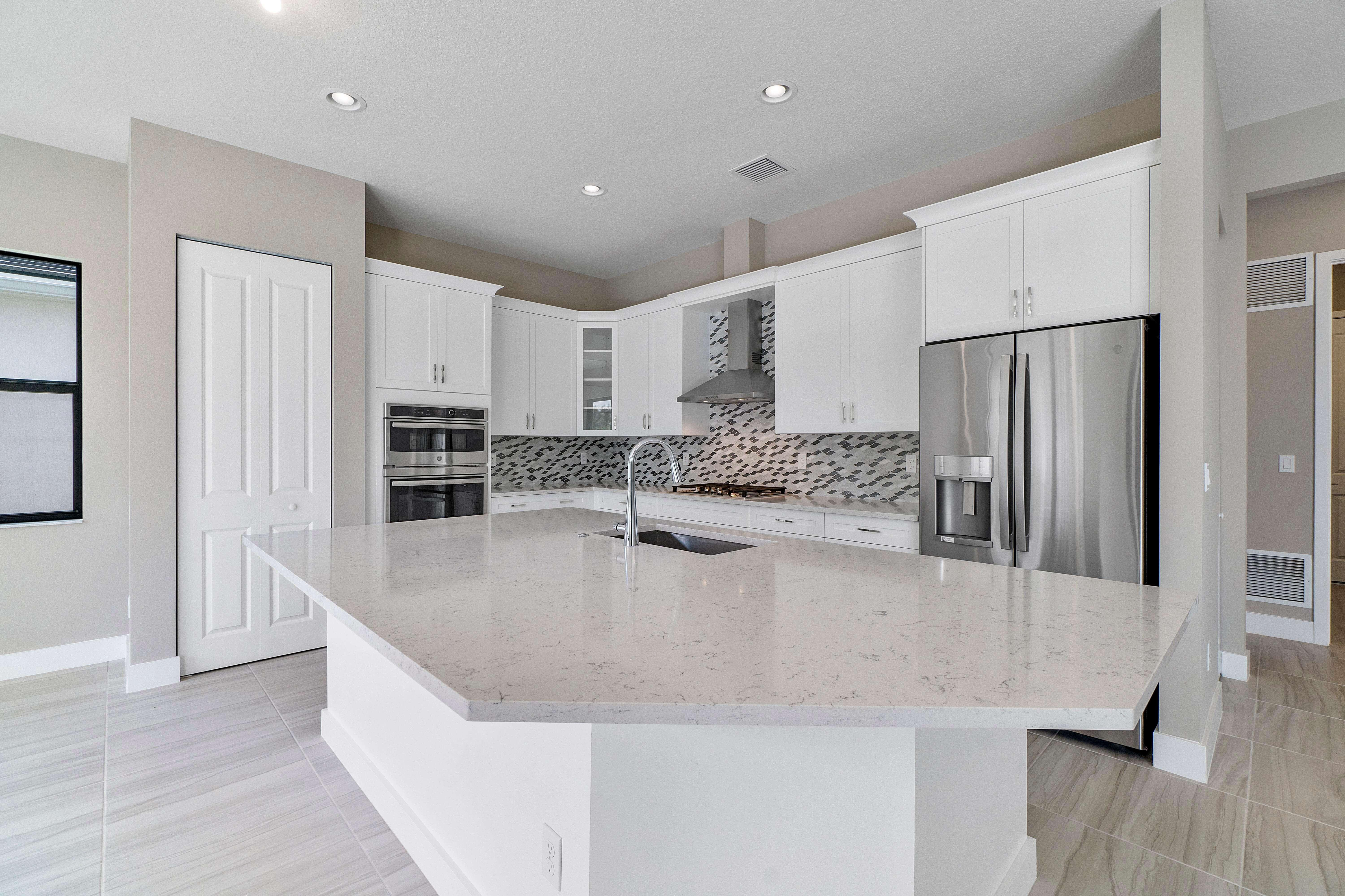 Kitchen featured in the Riviera By Akel Homes in Palm Beach County, FL