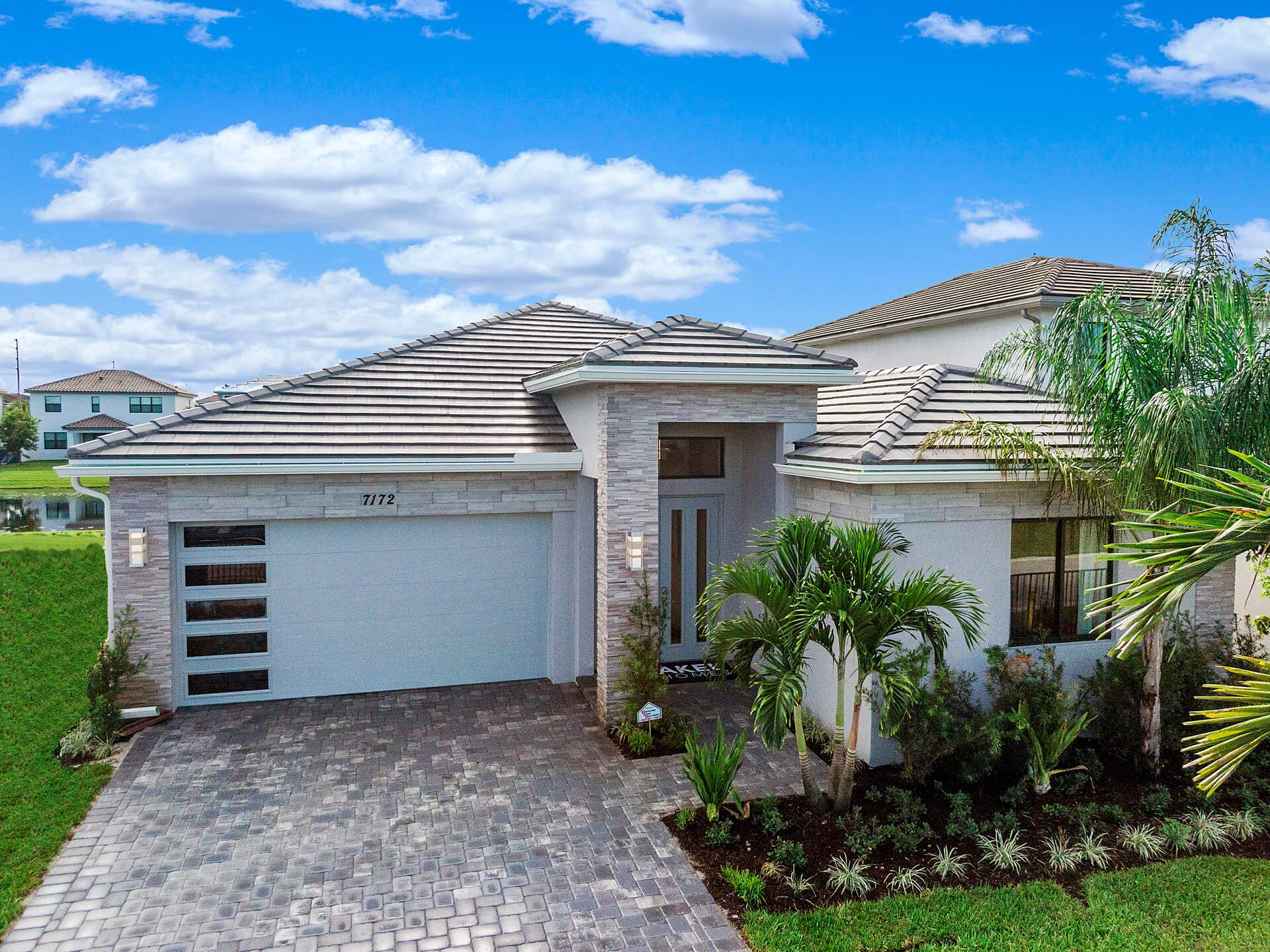 Exterior featured in the Rio Grand By Akel Homes in Palm Beach County, FL