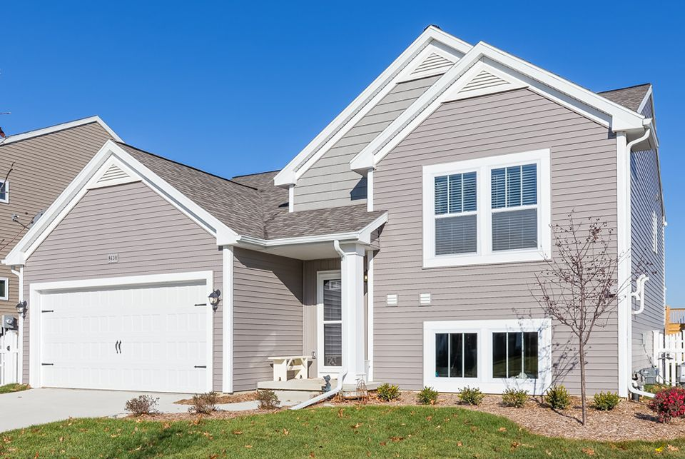 Classics 1750 model at 8625 manistee river drive for Home builders southeast michigan