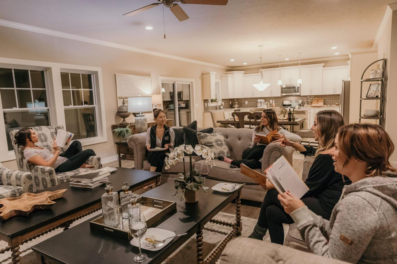 Community book club meeting inside of a house