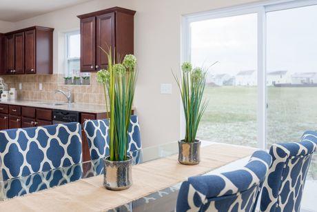 Kitchen-in-Elements 1680-at-Prairie Run North-in-Cedar Springs
