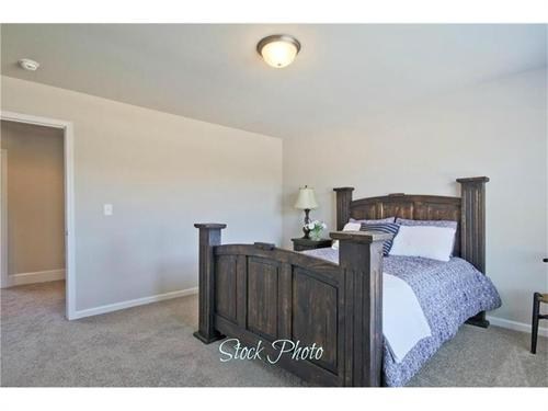 Bedroom-in-The Claire-at-Park Walk at Lanier-in-Flowery Branch