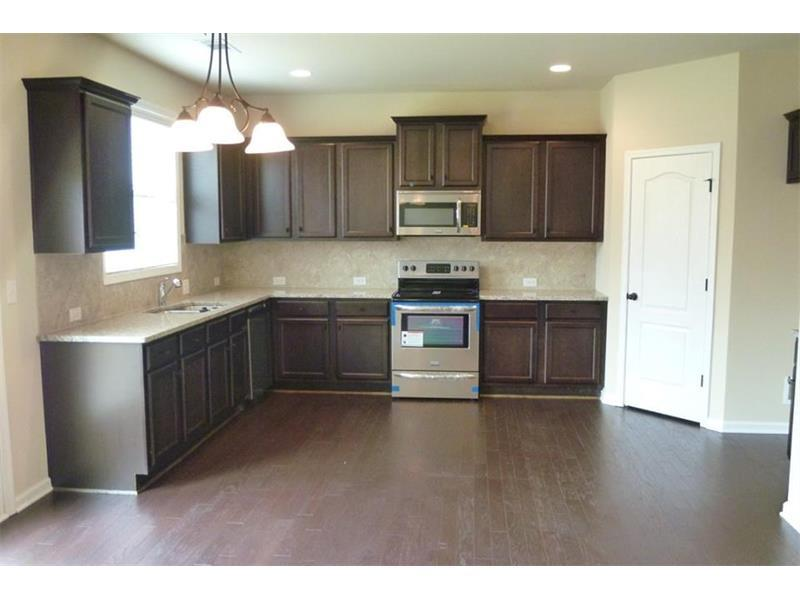 Kitchen-in-The Woodford-at-Park Walk at Lanier-in-Flowery Branch