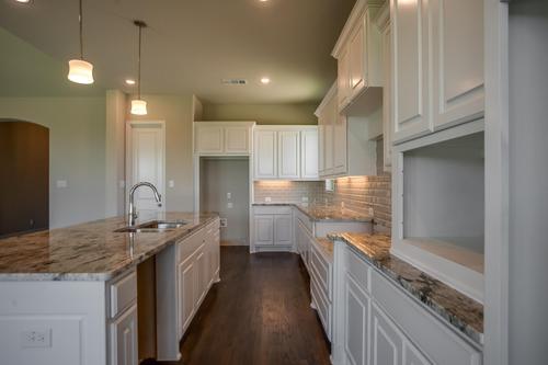 Kitchen-in-Plan 1702-at-Lilyana - 74s-in-Prosper