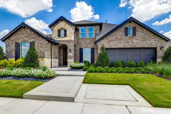 Plan 1686 Front Elevation Photo by American Legend Homes