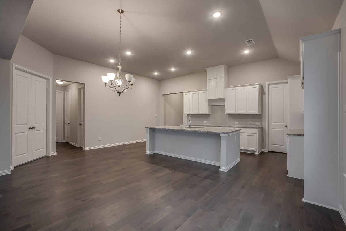 Kitchen featured in the Plan 1682 By American Legend Homes in Dallas, TX