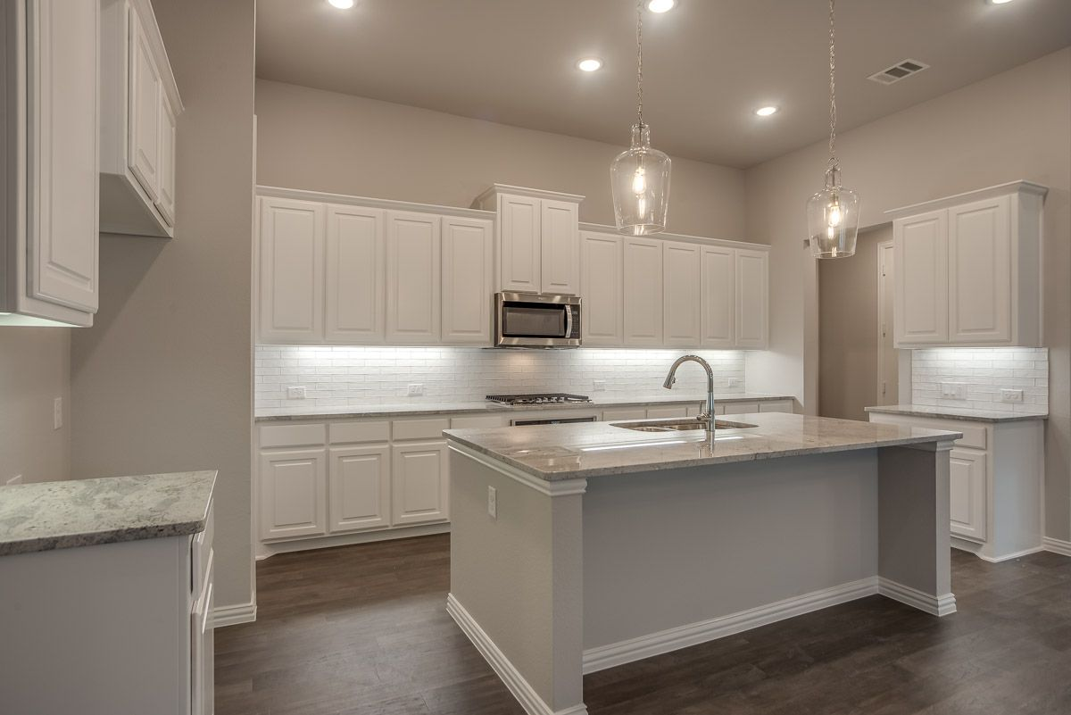 Kitchen featured in the Plan 1591 By American Legend Homes in Dallas, TX