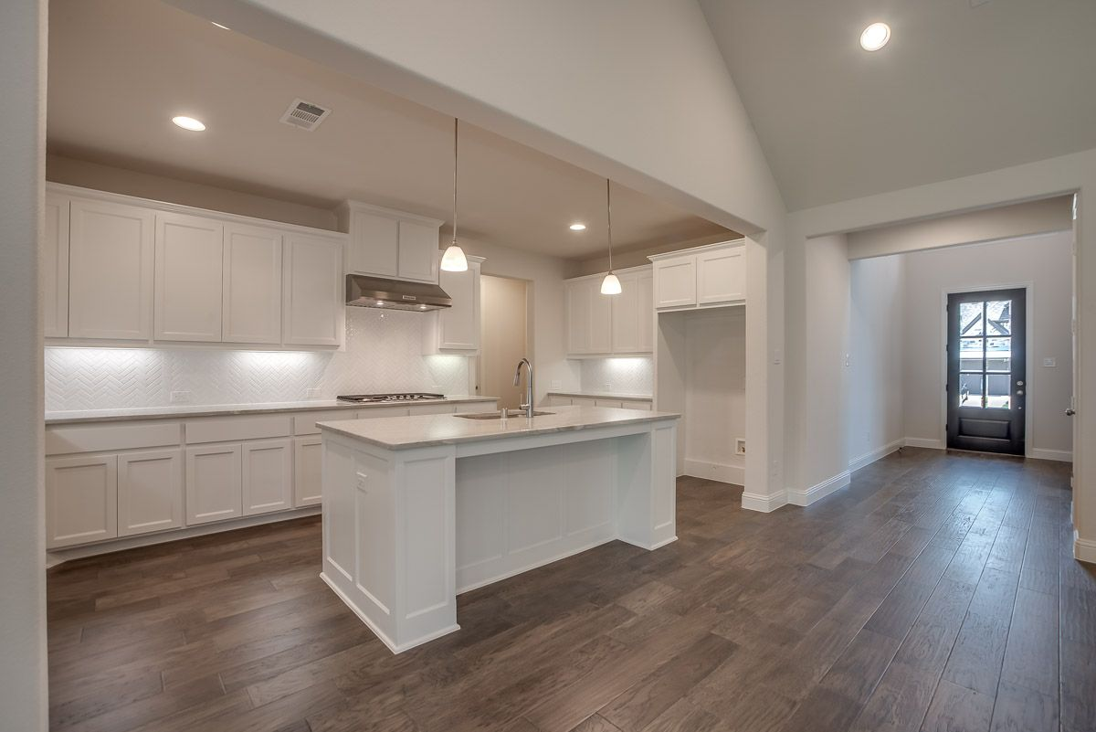 Kitchen featured in the Plan 1504 By American Legend Homes in Dallas, TX