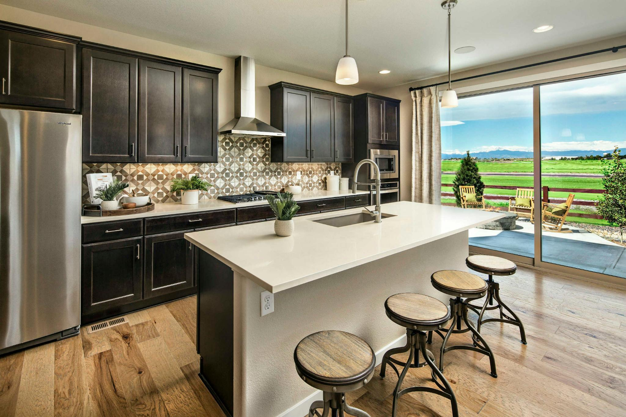 Kitchen featured in the Plan C407 By American Legend Homes in Greeley, CO
