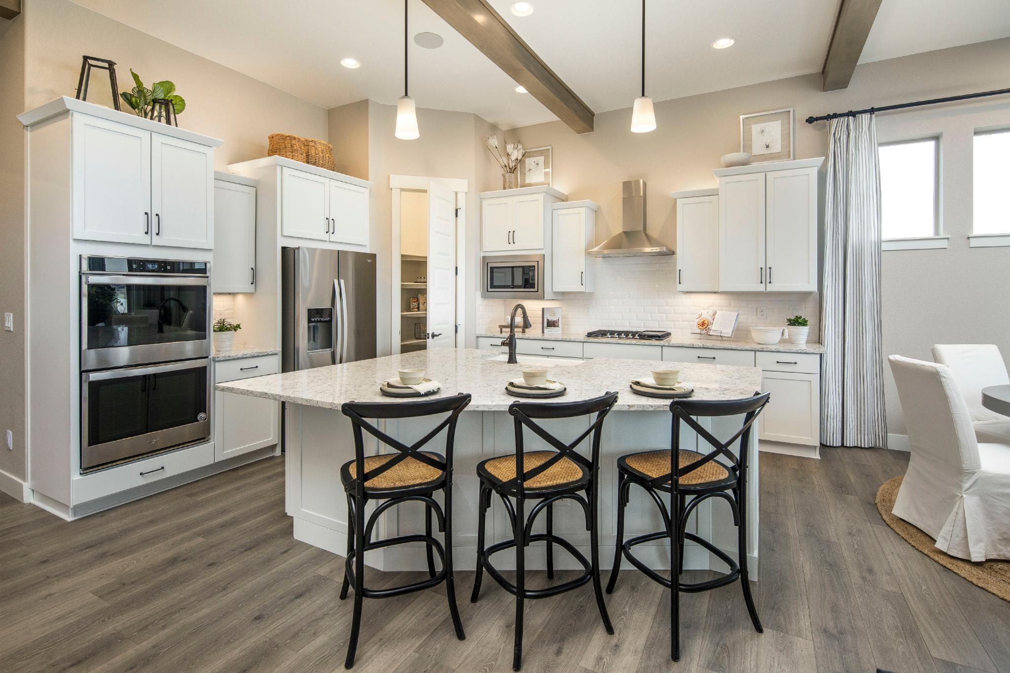 Kitchen featured in the Plan C408 By American Legend Homes in Fort Collins-Loveland, CO