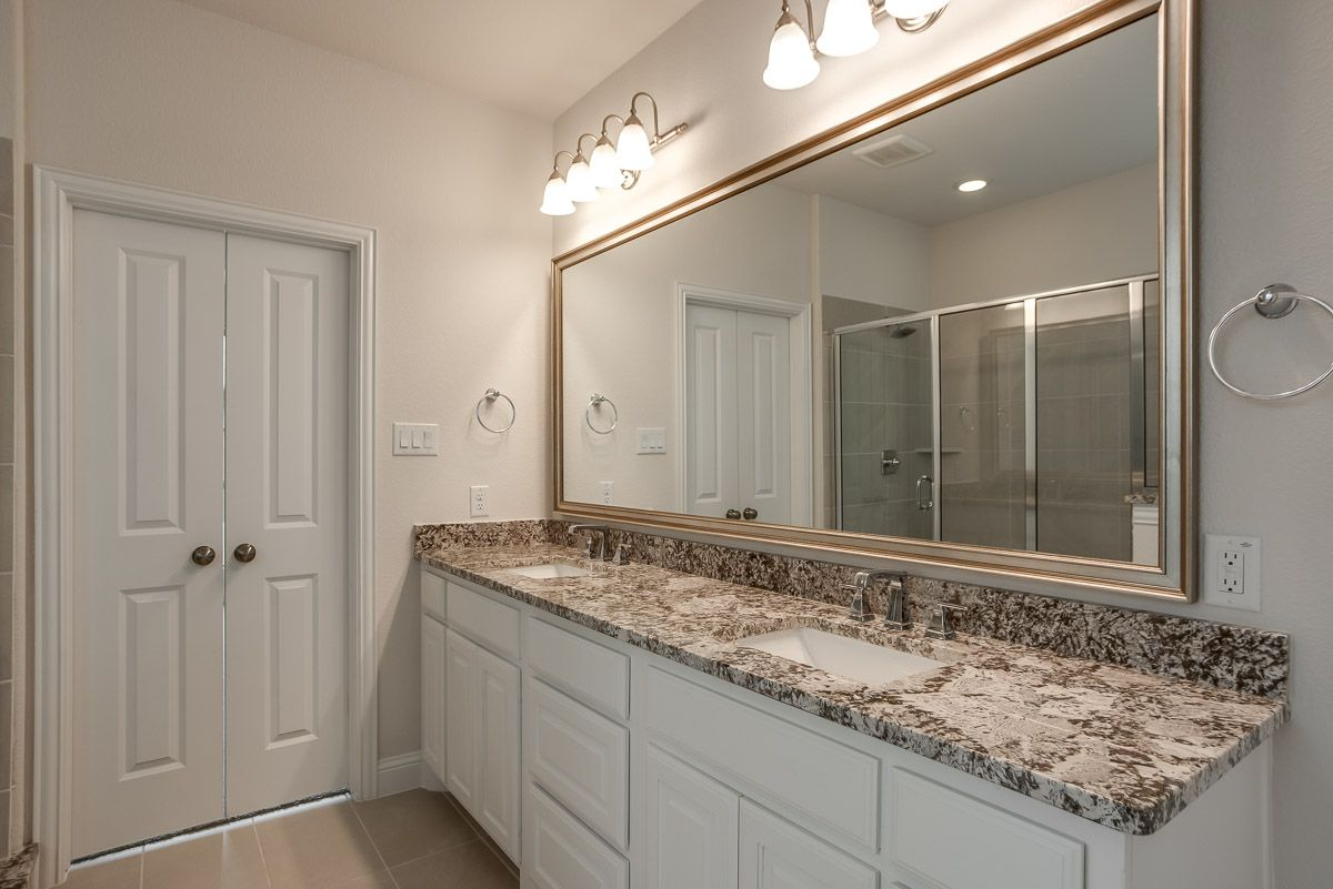 Bathroom featured in the Plan 1604 By American Legend Homes in Fort Worth, TX