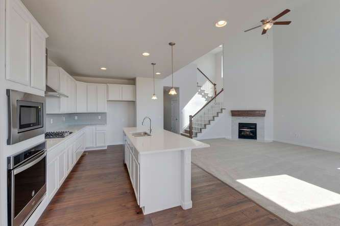 Kitchen featured in the Plan C405 By American Legend Homes in Greeley, CO