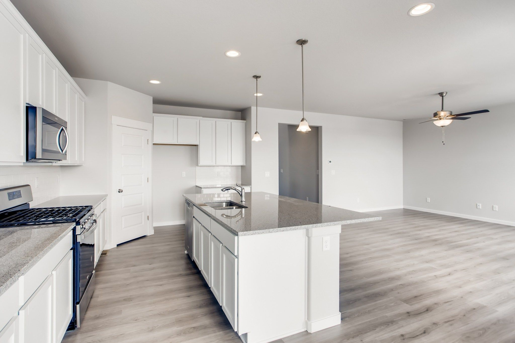 Kitchen featured in the Plan V419 By American Legend Homes in Fort Collins-Loveland, CO