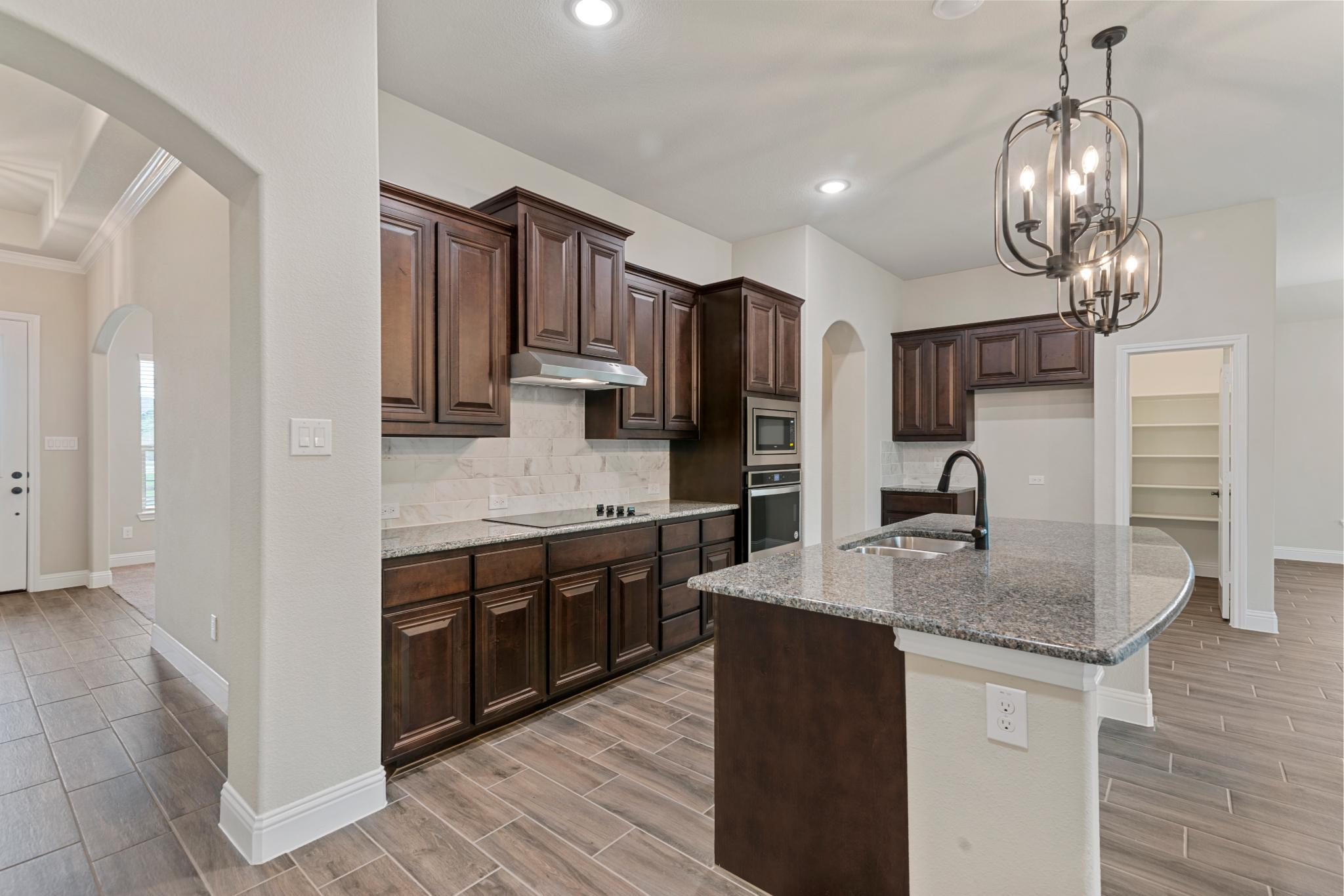 Kitchen featured in the 2404 By Antares Homes in Dallas, TX