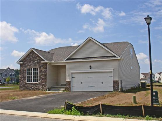 Windsor at Pinehurst Front:Windsor includes 2 car garage, stone accents, carriage style doors