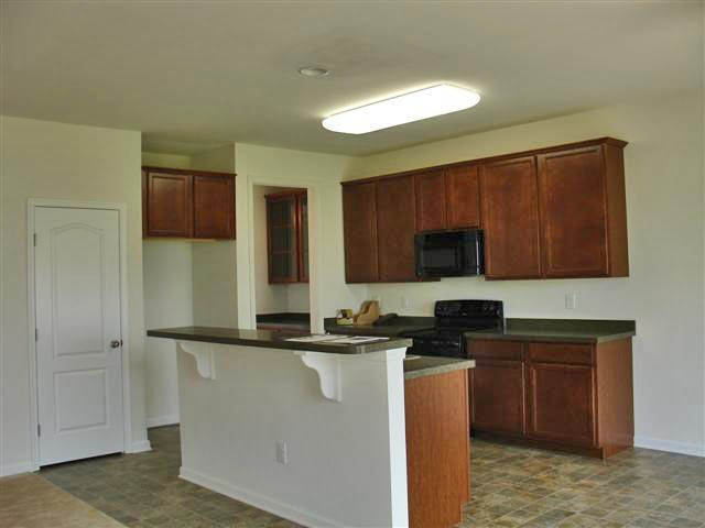 Kitchen featured in the Windsor Rancher at Pinehurst Village By Ashburn Homes in Dover, DE