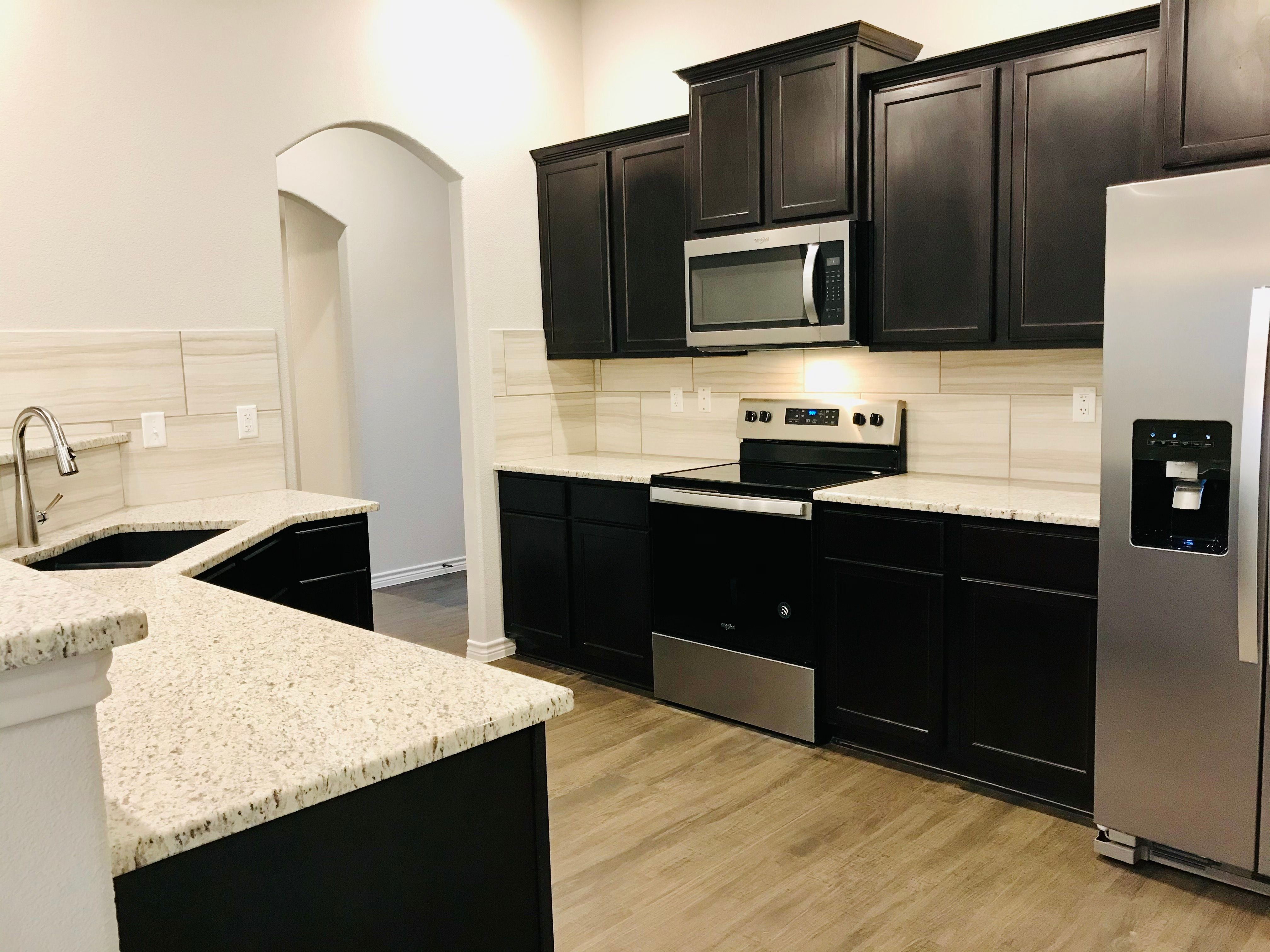 Kitchen featured in the Spring Valley By Ashford Homes in Killeen, TX