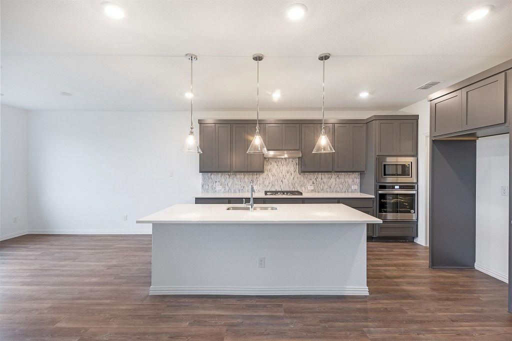 Kitchen featured in the Grayson By Ashton Woods in Dallas, TX