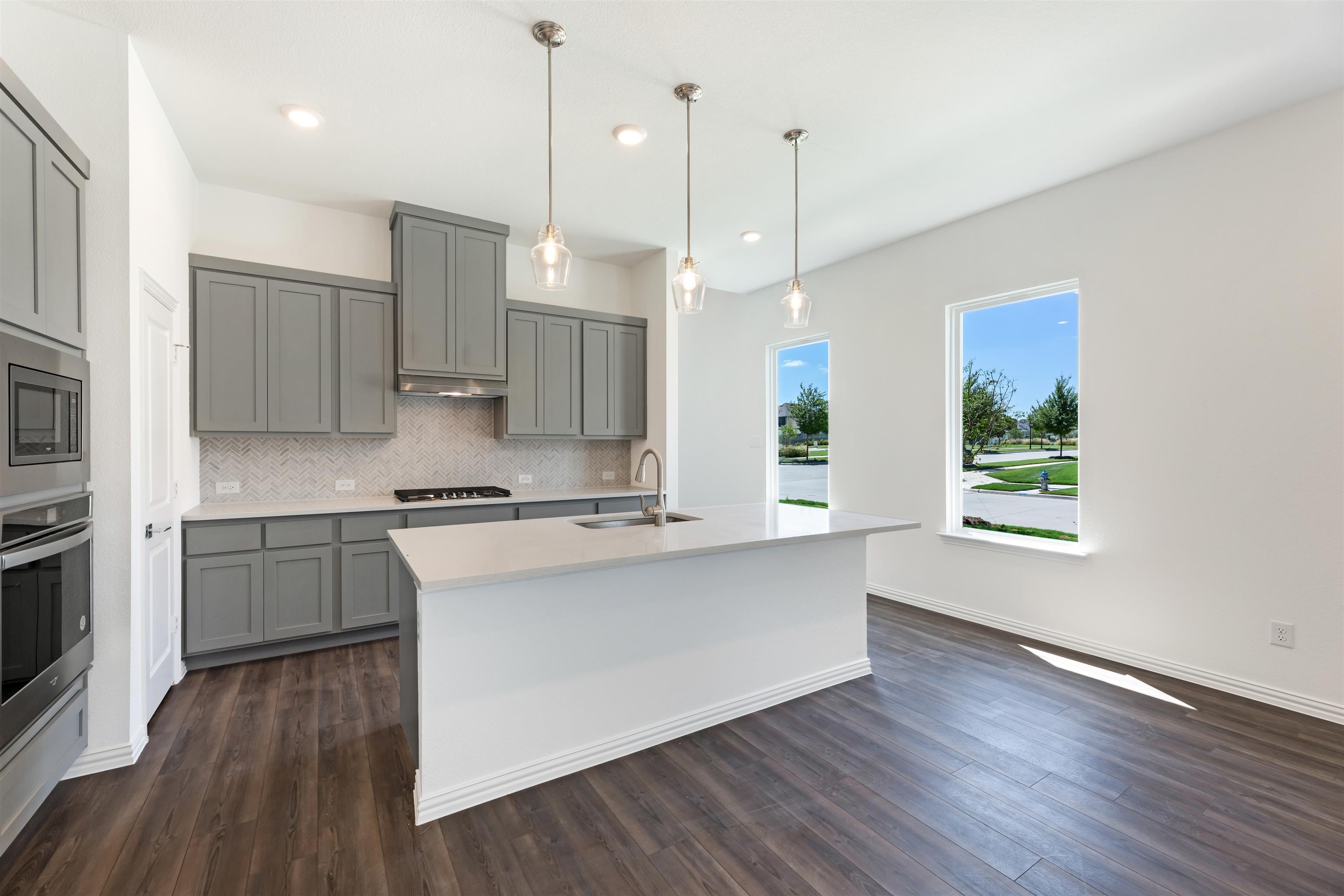 Kitchen featured in the Aubrey By Ashton Woods in Dallas, TX