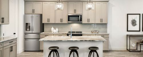 Kitchen-in-Murano-at-Estates at Sweetwater Country Club Townhomes-in-Apopka