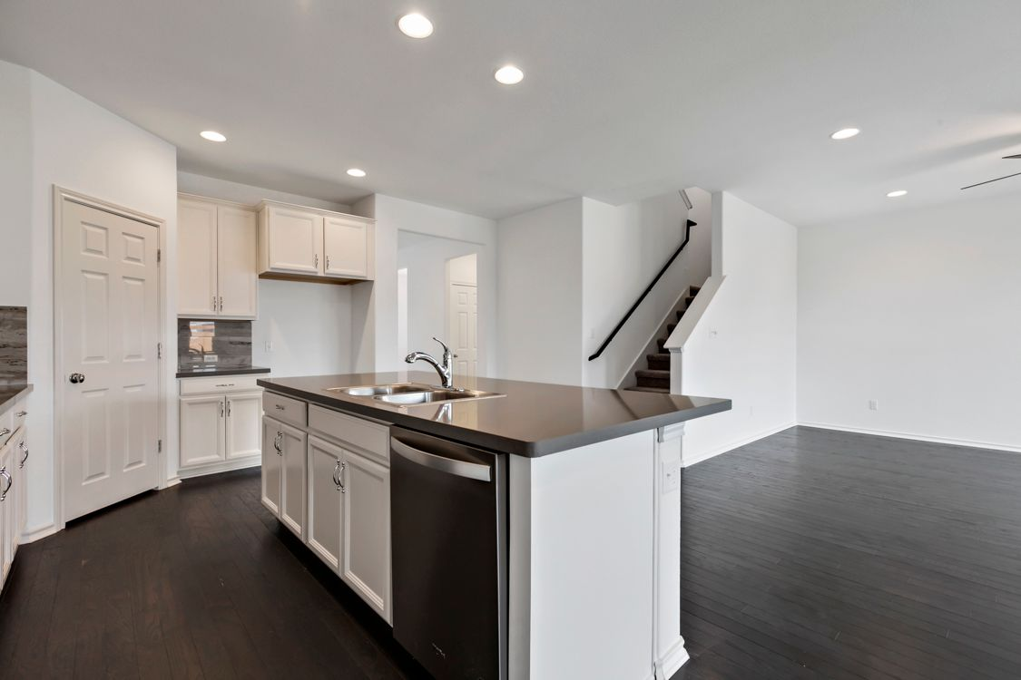 Kitchen featured in the Portsmouth By Ashton Woods in Austin, TX