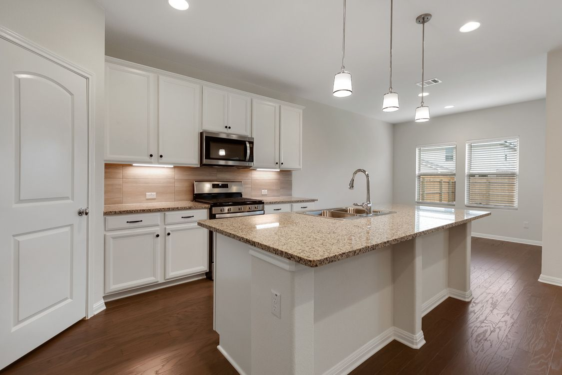 Kitchen featured in the Cambridge By Ashton Woods in Austin, TX