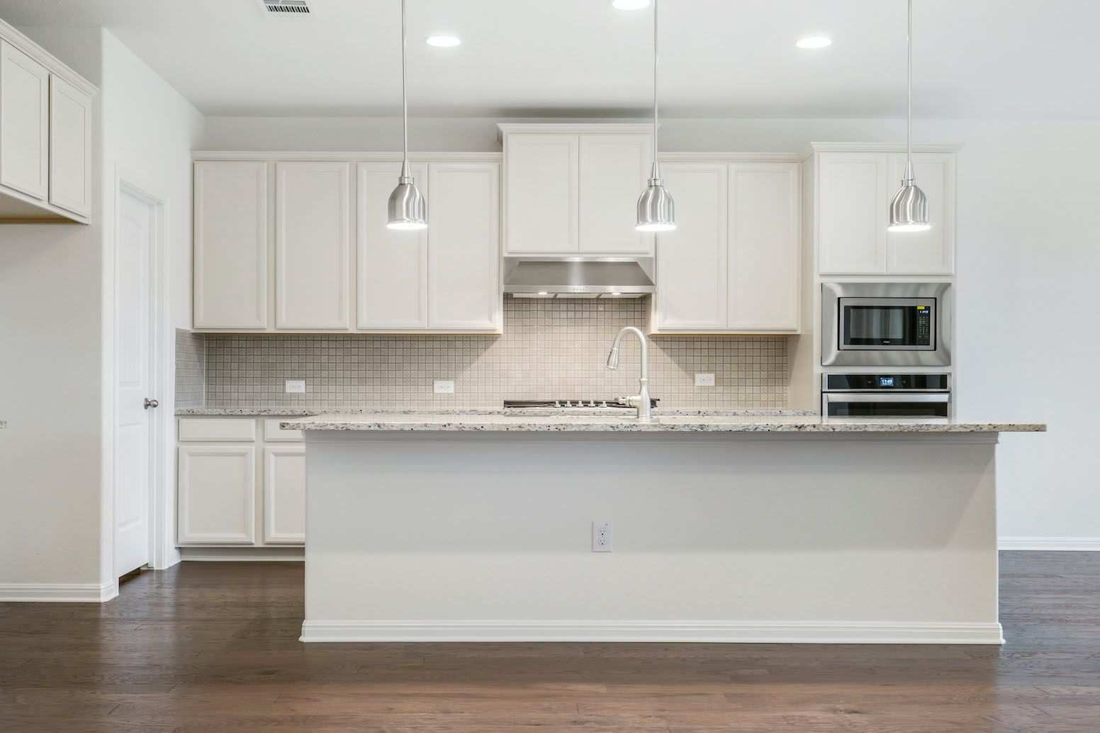 Kitchen featured in the Arnette By Ashton Woods in Austin, TX