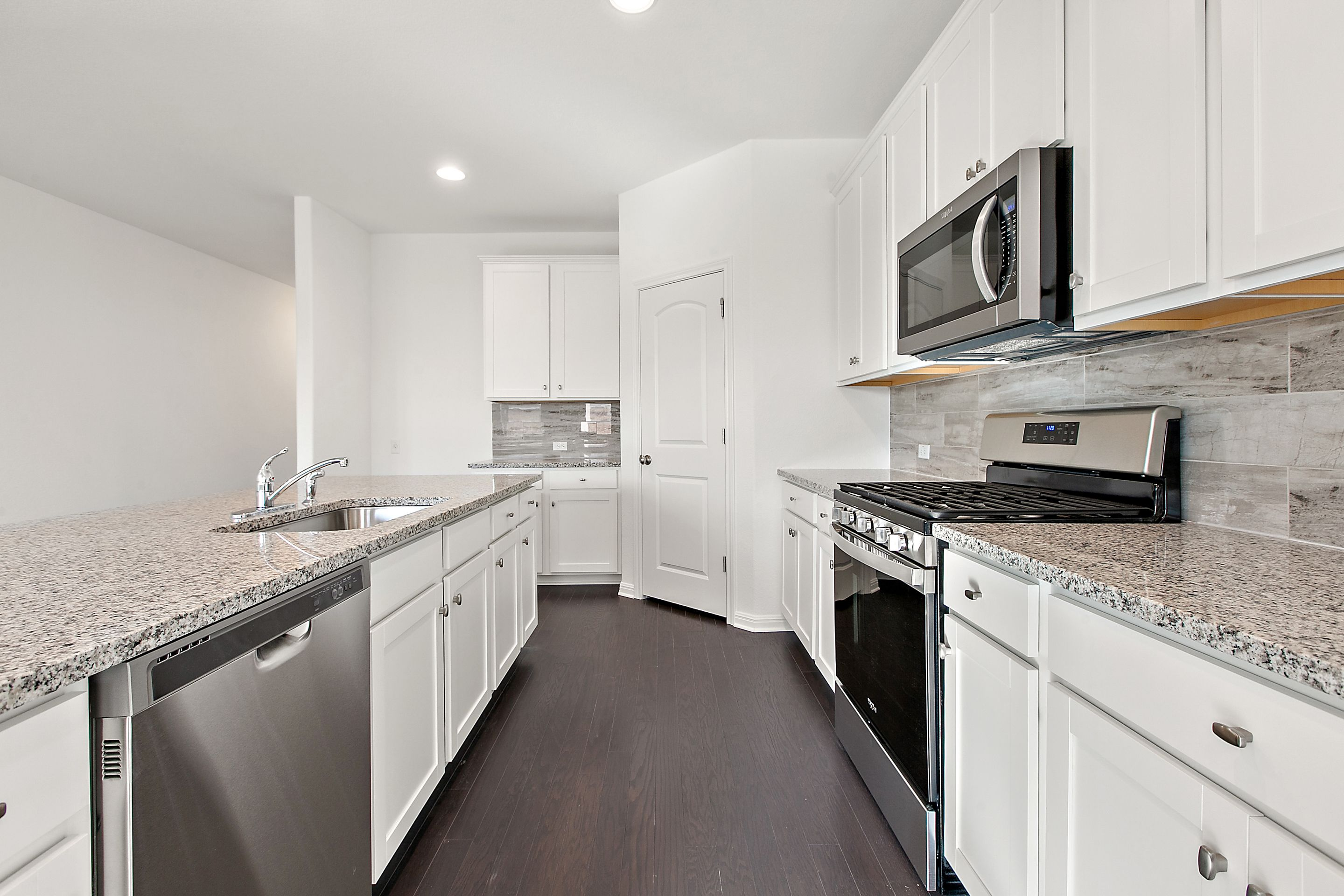 Kitchen featured in the Sheffield By Ashton Woods in Austin, TX