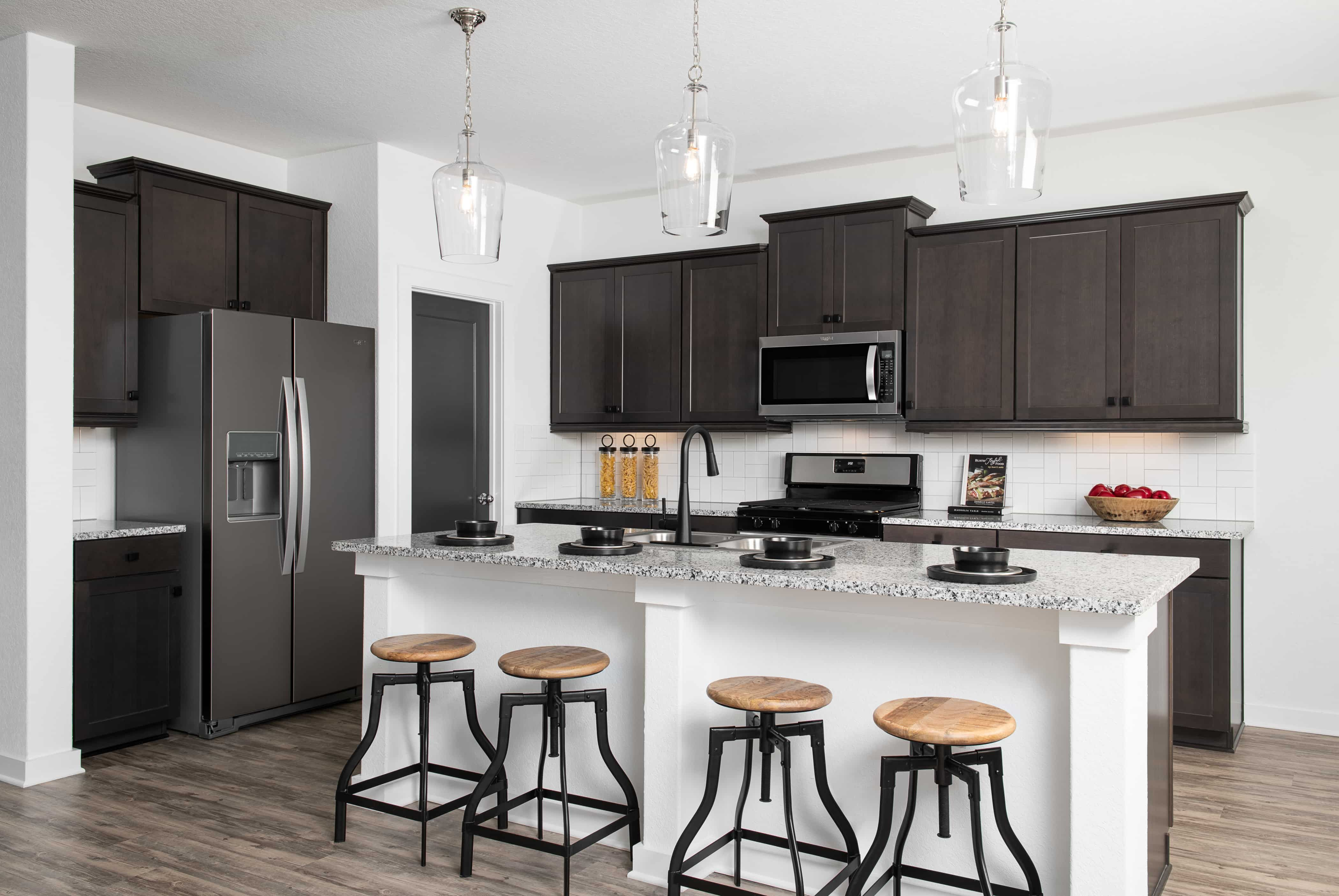 Kitchen featured in the Jordan By Ashton Woods in San Antonio, TX