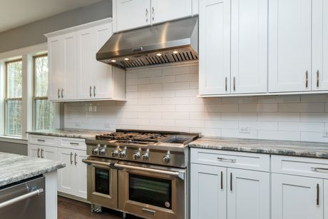 Kitchen-in-The Sarasota-at-Lochridge-in-Holly Springs
