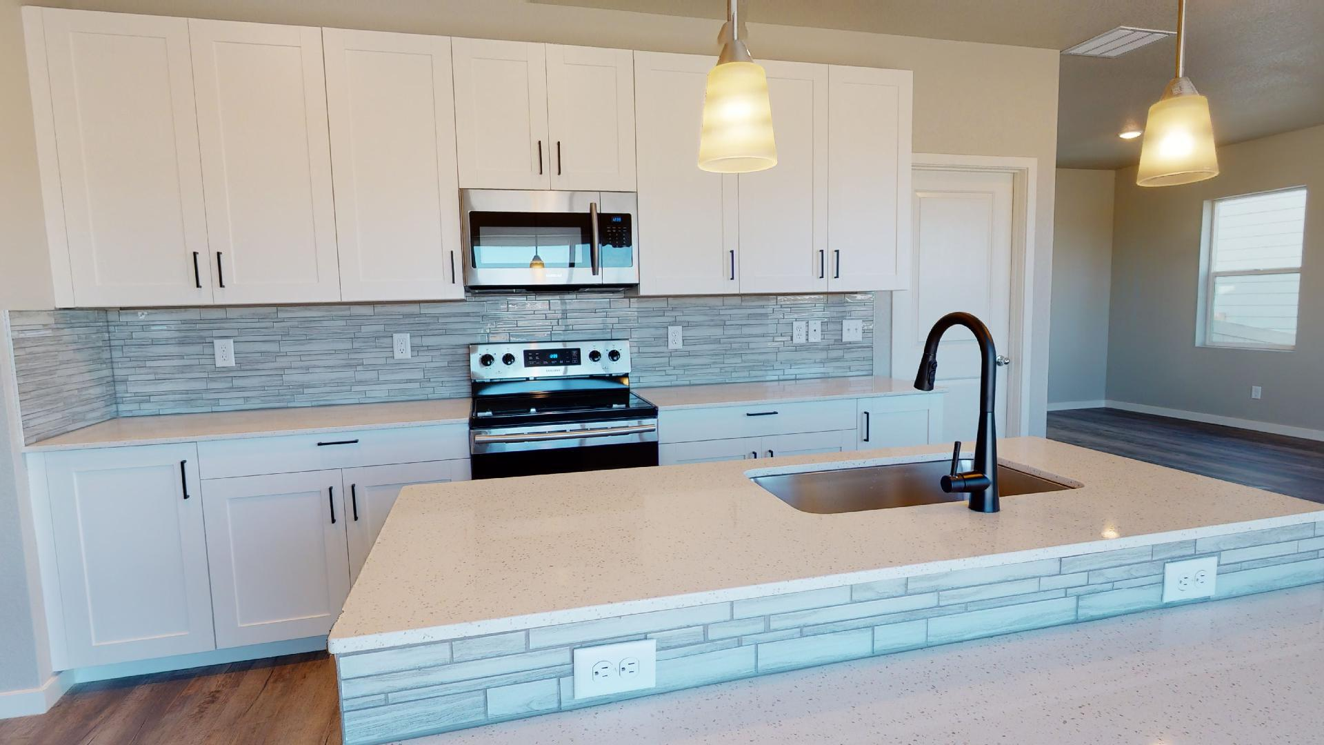 Kitchen featured in the Welby By Baessler Homes in Greeley, CO