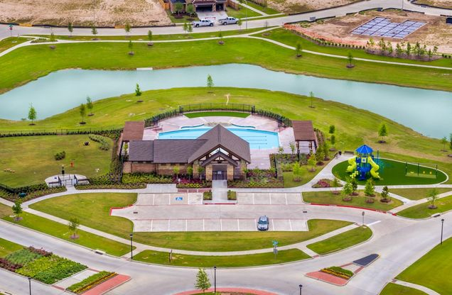 Why Beazer Cameron French Country Exterior Recreation center with pool and splash pad