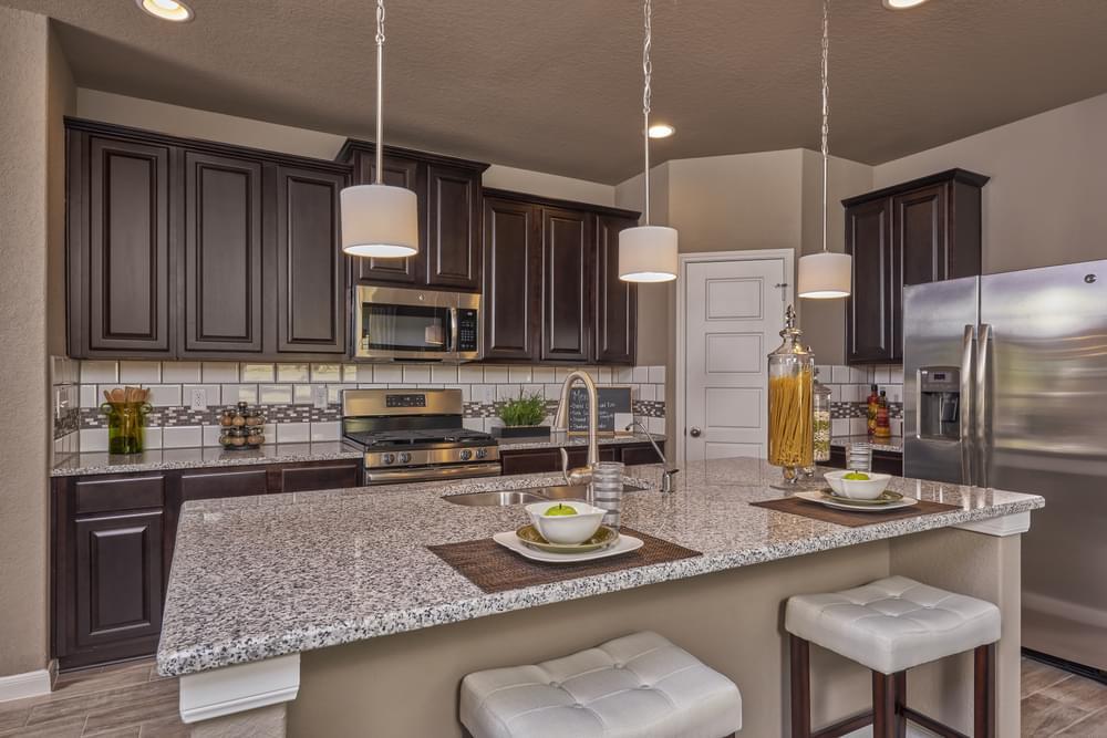 Kitchen featured in The Avondale By Bella Vista Homes in San Antonio, TX