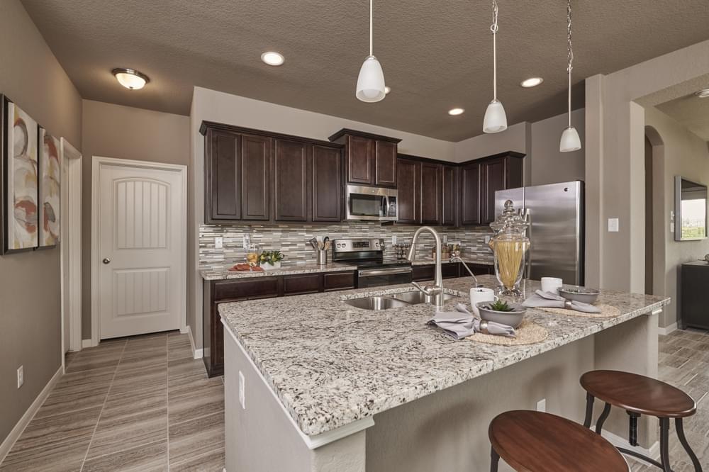 Kitchen featured in The Ridgeview By Bella Vista Homes in San Antonio, TX