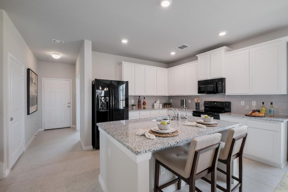 Kitchen featured in The Ellington By Bella Vista Homes in San Antonio, TX