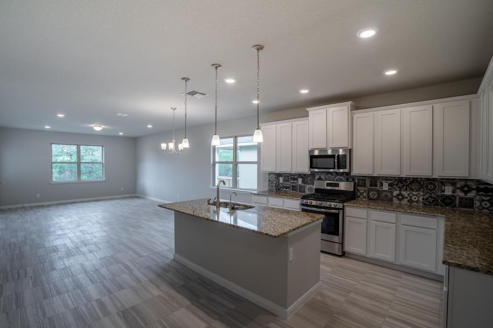 Kitchen featured in The Chandler By Bella Vista Homes in San Antonio, TX