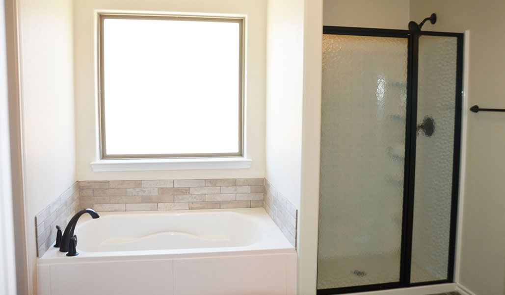 Bathroom featured in the Carmi By Betenbough Homes in Lubbock, TX