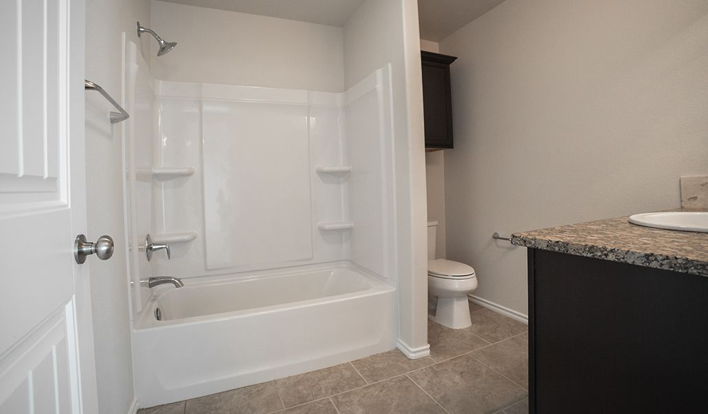 Bathroom featured in the Laura By Betenbough Homes in Lubbock, TX
