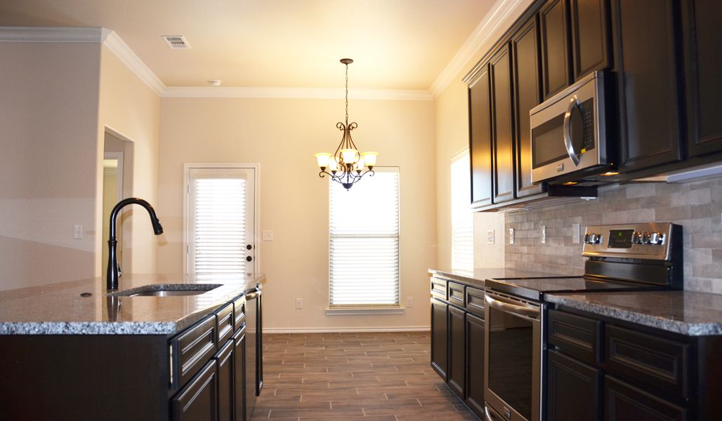 Kitchen featured in the Rosa By Betenbough Homes in Lubbock, TX