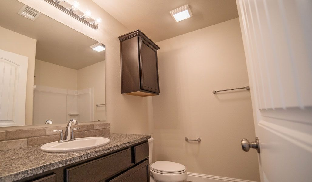 Bathroom featured in the Carol Anne By Betenbough Homes in Lubbock, TX