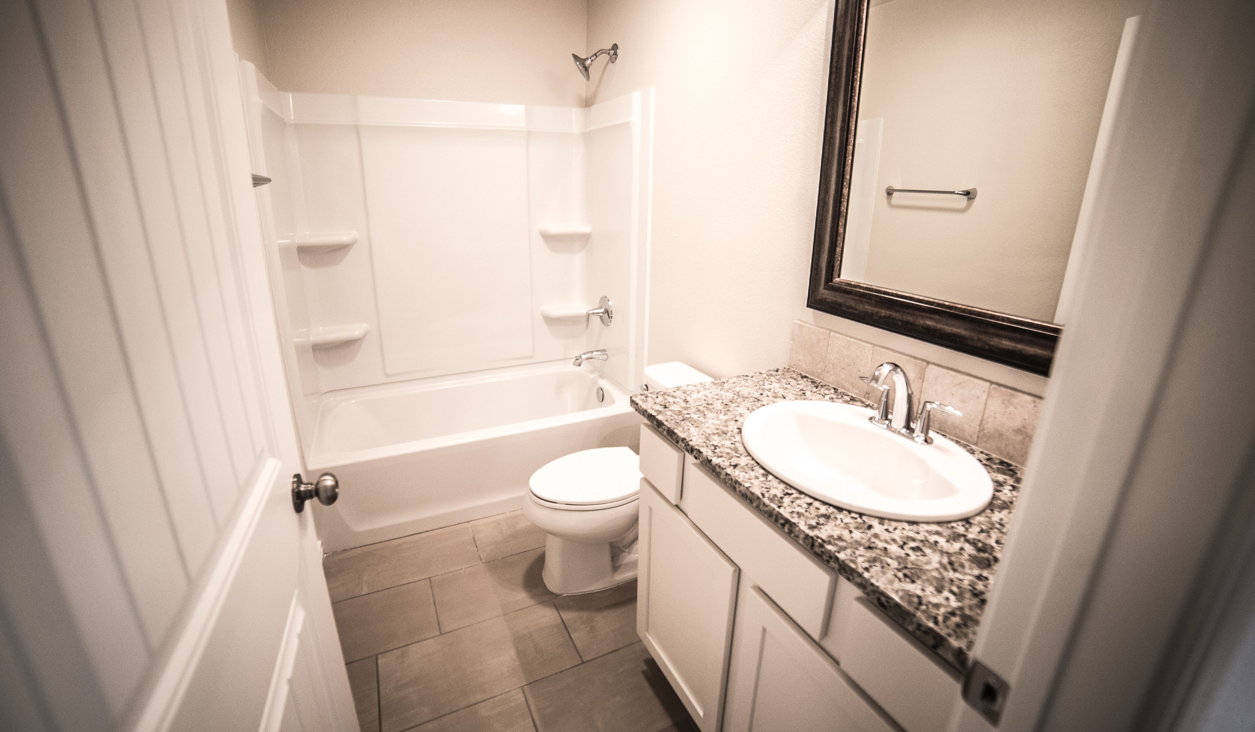 Bathroom featured in the Lynn By Betenbough Homes in Lubbock, TX