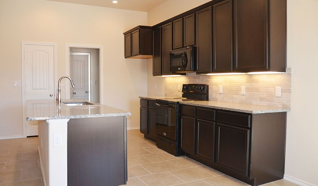 Kitchen featured in the Jade By Betenbough Homes in Midland-Odessa, TX